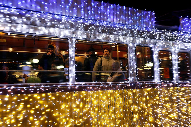 Hungarians travel on a tram decorated with Christmas lights in the centre of Budapest